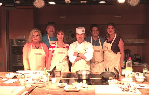 Sushi Chef Andy Matsuda, center, leads a private class onboard Nieuw Amsterdam.