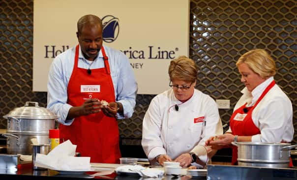 Holland America Line President Orlando Ashford demos how to make shu mai with ATK Host Julia Collin Davison, right, and HAL Instructor Barbara Mills Schuchardt.