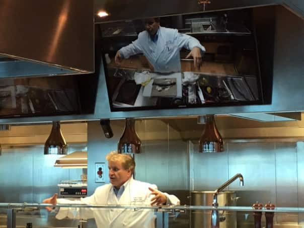 Giant screens around the room make it possible for all attendees to see the cooking action.