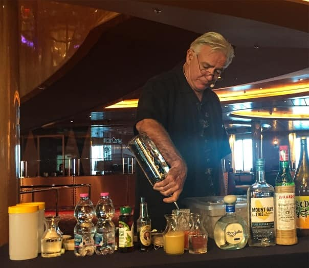 Dale DeGroff giving a private drink tutorial to Koningsdam guests.
