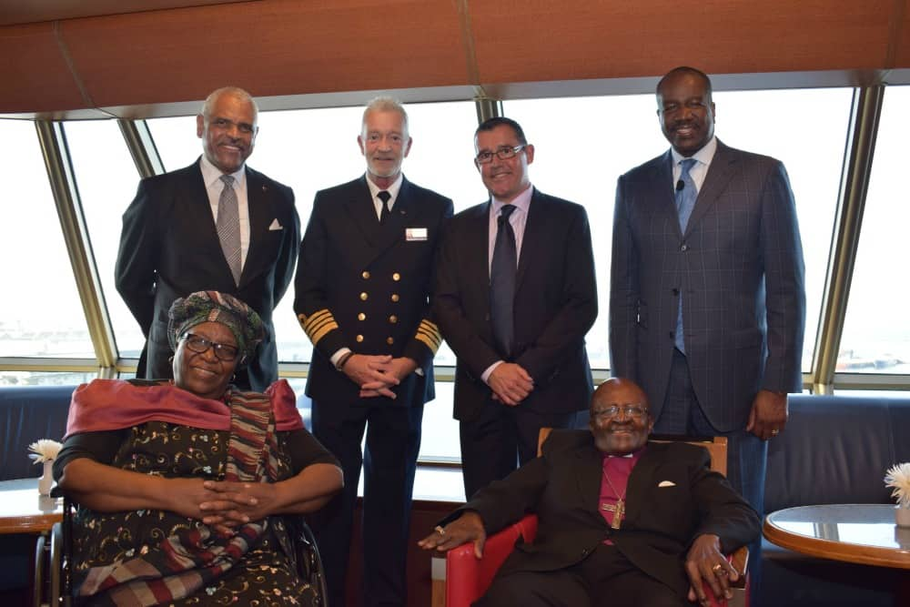 Back row, from left: Donald, Amsterdam Captain Jonathan Mercer, Taylor and Ashford. Front row from left: Leah and Archbishop Tutu.