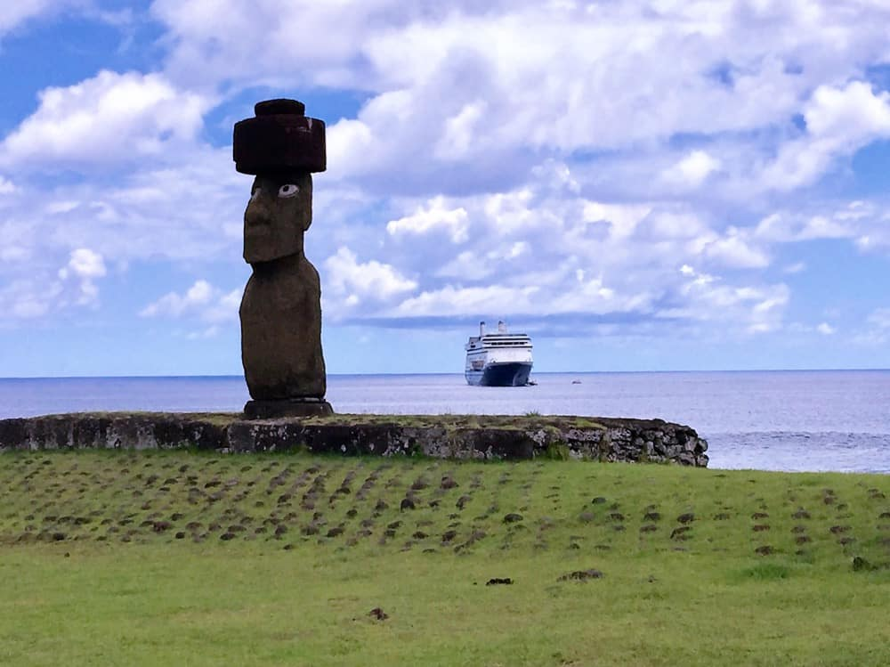Easter Island Tahai ceremonial center near Hanga Roa with MS Amsterdam in background