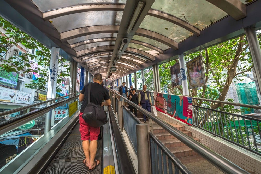 People using the Centra Mid Levels escalator in Hong Kong, the longest outdoor covered escalator system in the world.
