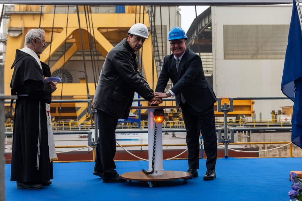 Pressing the button to begin the process is Antonio Quintano, director of Fincantieri's Marghera shipyard (left) and Keith Taylor, Holland America Group executive vice president, fleet operations.