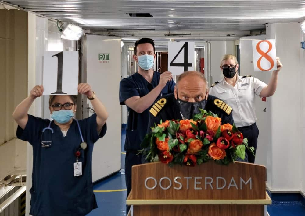 Oosterdam's captain and team members celebrate our 148th!