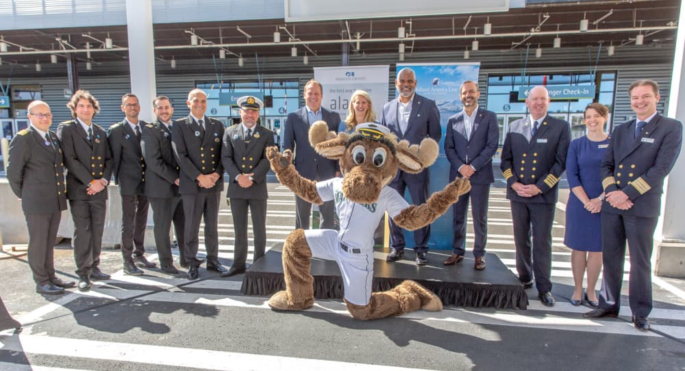 The ship's senior officers with (on stage, from left) Executive Director of Port of Seattle Steve Metruck, Princess Cruises President Jan Swartz, Carnival Corporation President & CEO Arnold Donald and Holland America Line President Gus Antorcha.