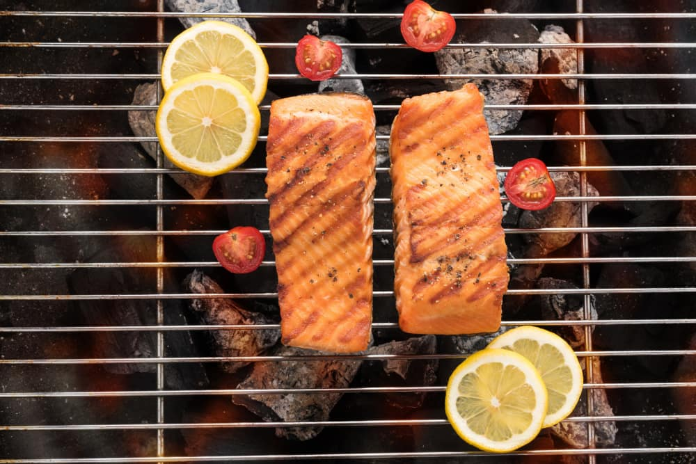 Grilled salmon with lemon on the flaming.