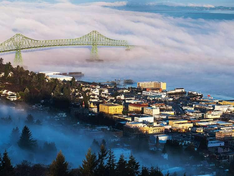 Fog hovers over the Columbia River; Astoria, Oregon, United States of America