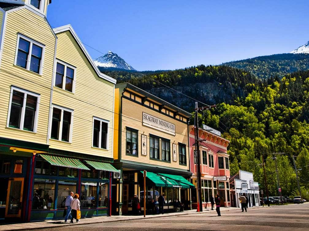 Tourists in historic downtown Skagway on a sunny day, Southeast Alaska, Summer