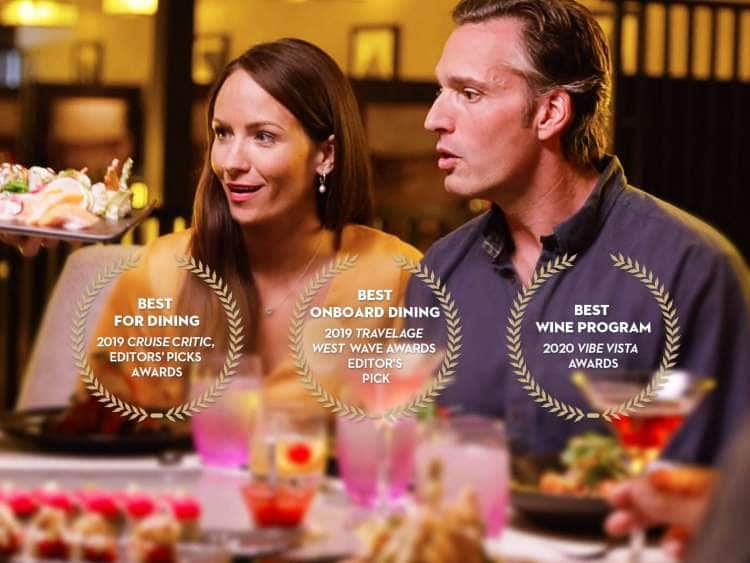 hungry couple admiring sushi plate with note of 3 awards to holland america line. best for dining award given by 2019 cruise critic editor's picks awards. best onboard dining award given by 2019 travel age west wave awards editor's pick. best wine program 2020 award from vibe vista