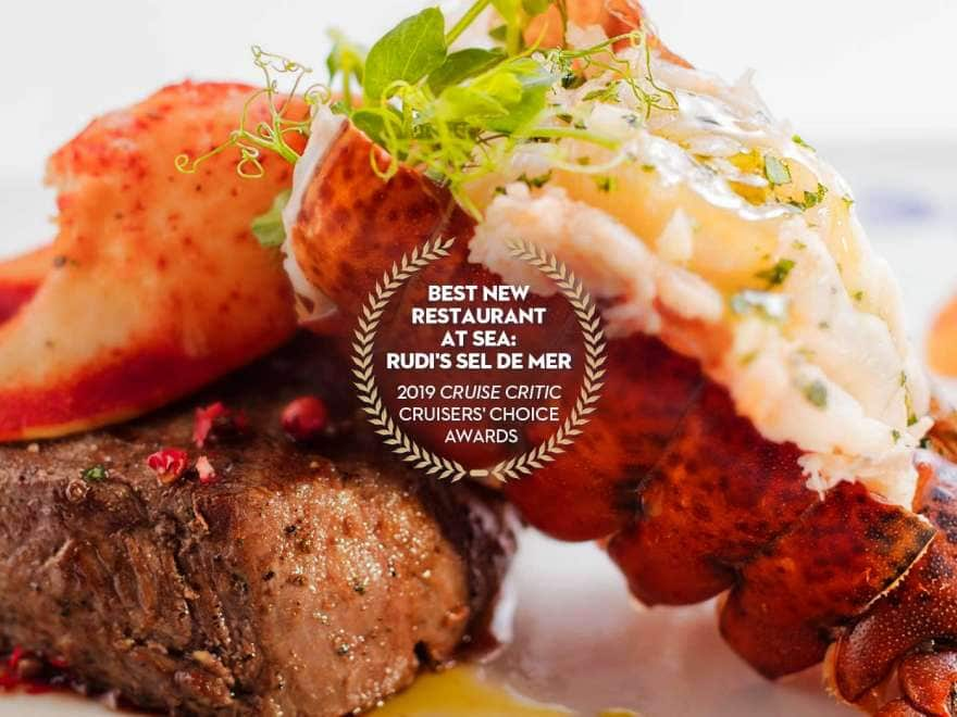 a gourmet steak and lobster meal with notes of award for best new restaurant at sea from 2019 cruise critic cruiser's choice awards