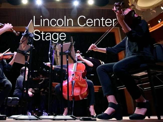 String quartet performing on stage with piano accompaniment