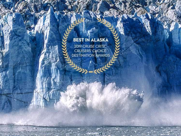 Glacier calves into the ocean.  Logo reads: Best in Alaska - 2019 Cruise Critic Cruiser's Choice Destination Awards