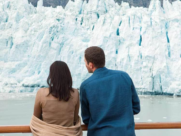 A couple views the glaciers on an Alaska cruise