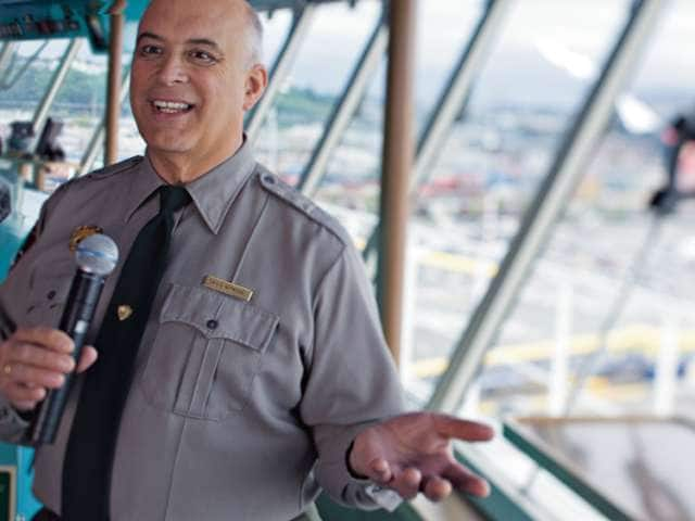 National Park Service ranger speaking with microphone on the observation deck on an Alaska cruise