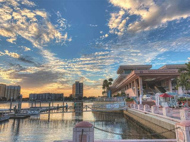 Sunset view of the Tampa Convention Center and pier.