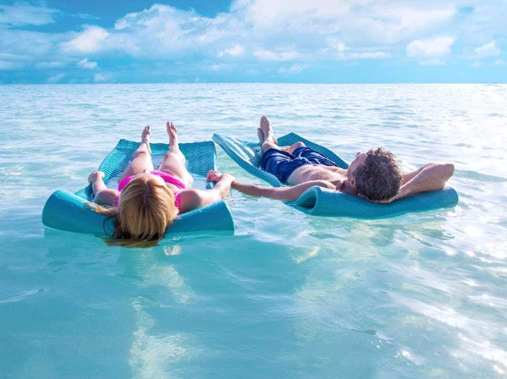 View of a couple relaxing in the water while on a Caribbean cruise
