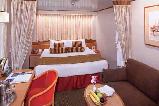 Interior stateroom with queen bed configuration