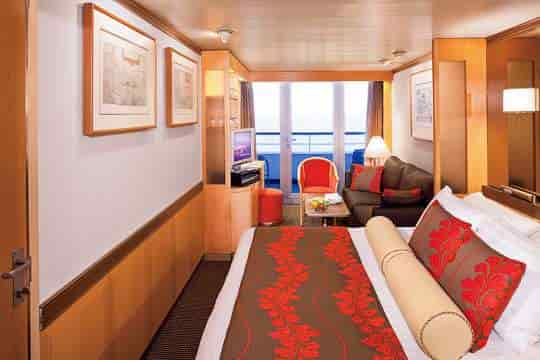 Vista Suite stateroom with queen bed configuration