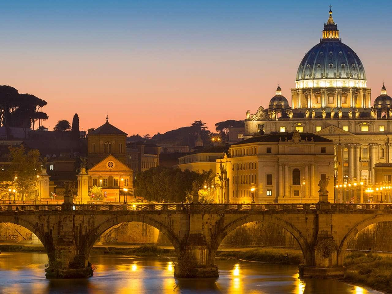 Twilight over River Tibor and the dome of San Pietro, Vatican, Rome, Lazio, Italy. Visit the Rome forum on a Holland America Line European cruise.
