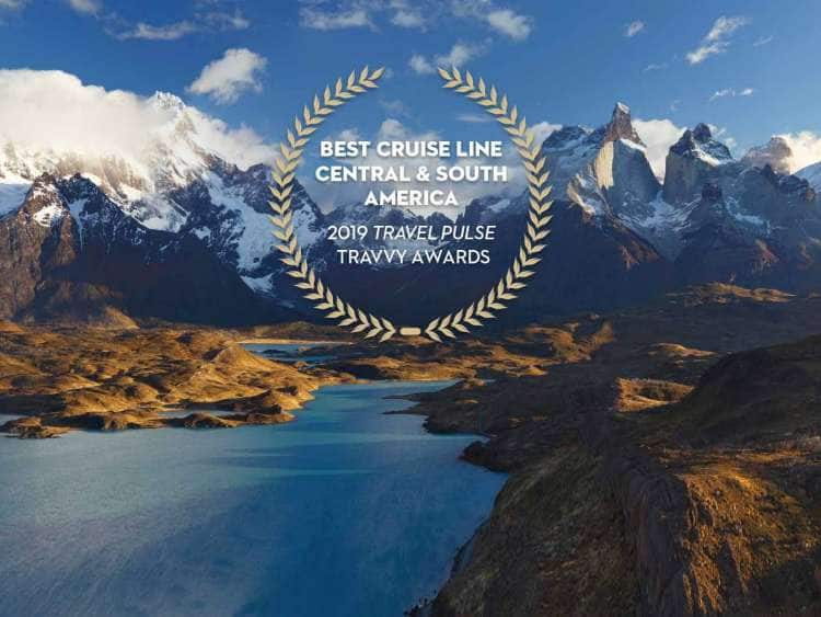 A photo of the Andes Mountains along with notice of a 2019 Travy award for Best Cruise Line Central & South America from Travel Pulse