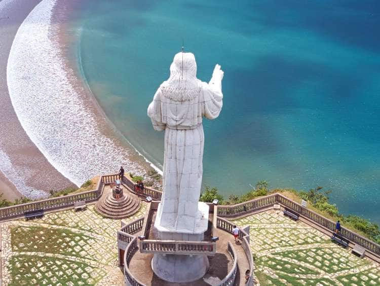 Aerial view of a religious statue overlooking a beach in San Juan Del Sur, Nicaragua on a Panama Canal cruise excursion