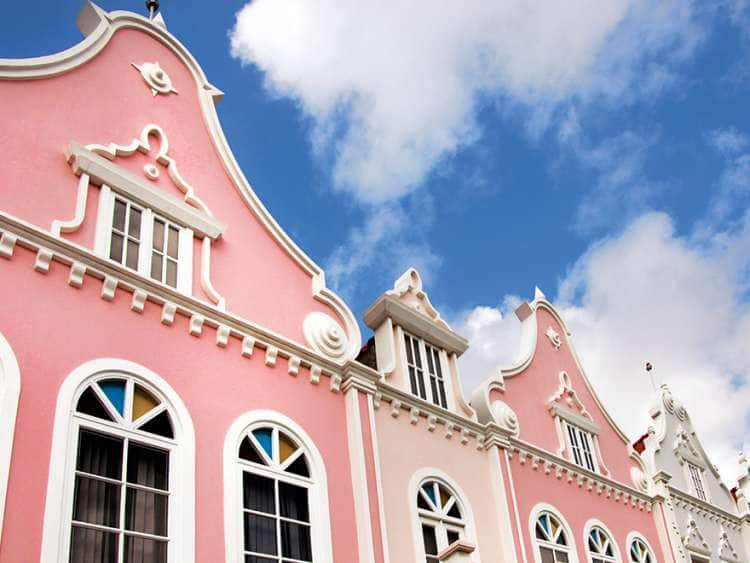 Pink houses against a bright blue sky
