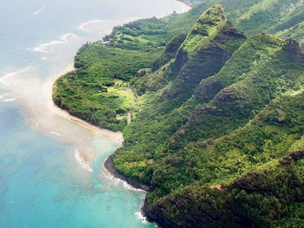 A Hawaii and Tahiti cruise deal showing an amazing aerial coastal view of a beach