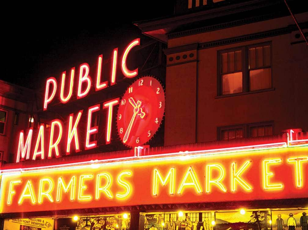 A picture of Pikes Place Market Sign which can be part of a Pacific N.W. and Pacific Coast cruise package