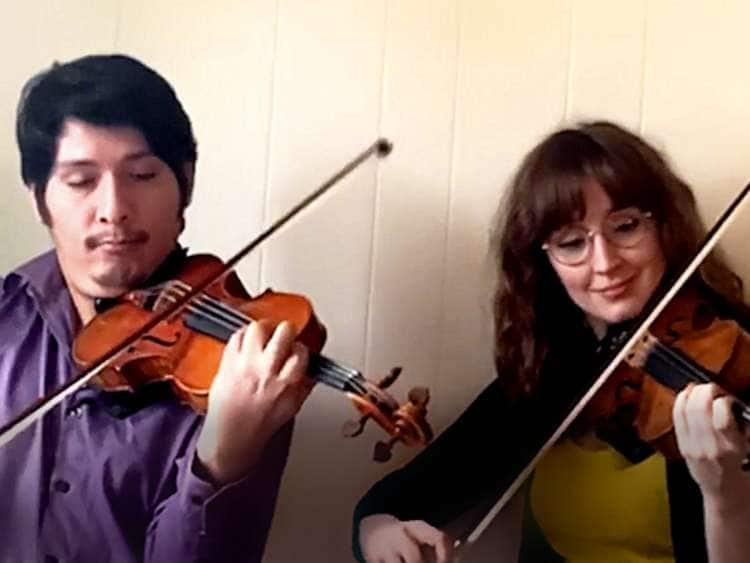 Violinists Jesus Sanez and Kelley McGary performing a duo