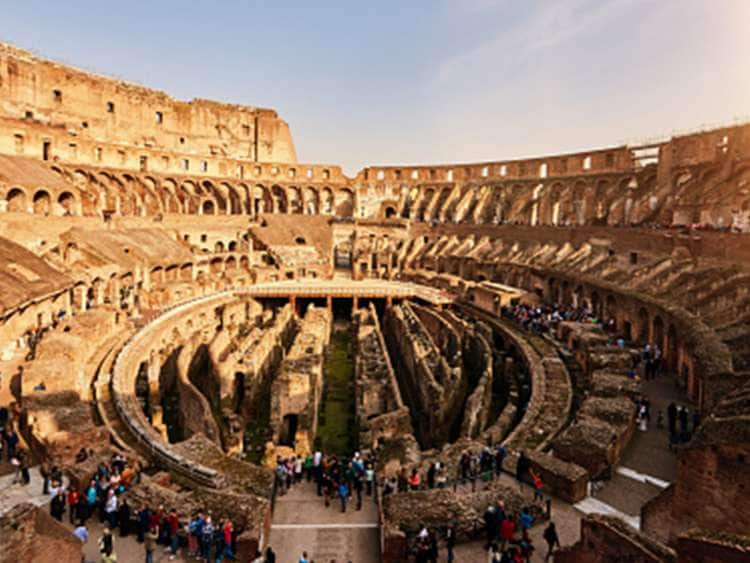 View of tourist exploring the historic Rome Colosseum while on a Holland America Line transatlantic cruise